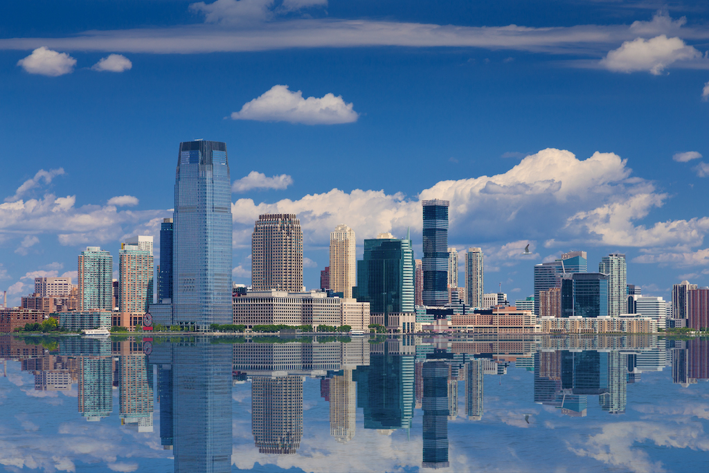 Jersey City Skyline With Goldman Sachs Tower Reflected In Water Of Hudson River, New York, USA.